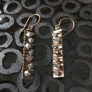 Drop earrings with metallic stones